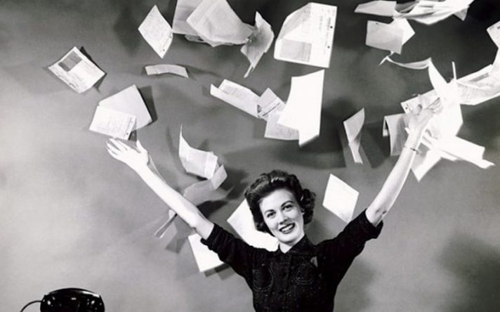 woman-vintage-black-and-white-throwing-bills-paper-into-air-800x500